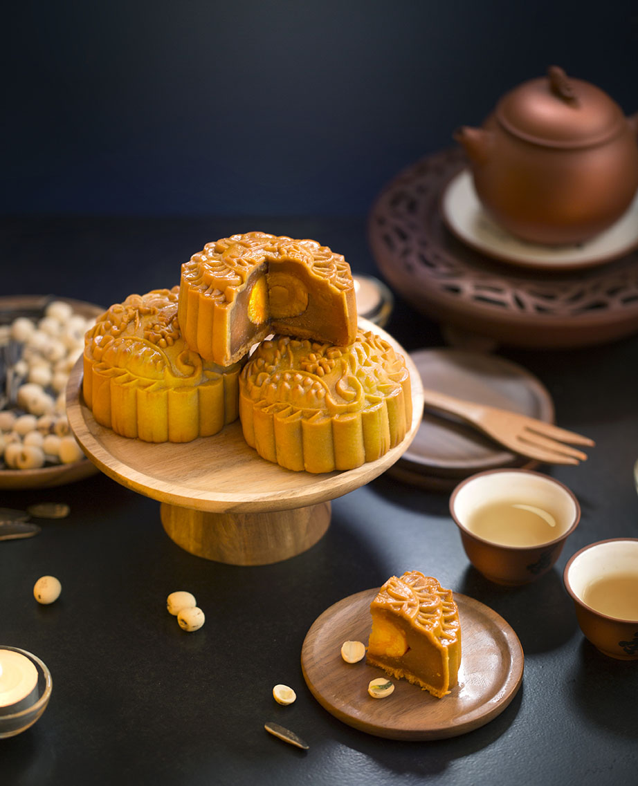 Chinese mooncake served on black table top.