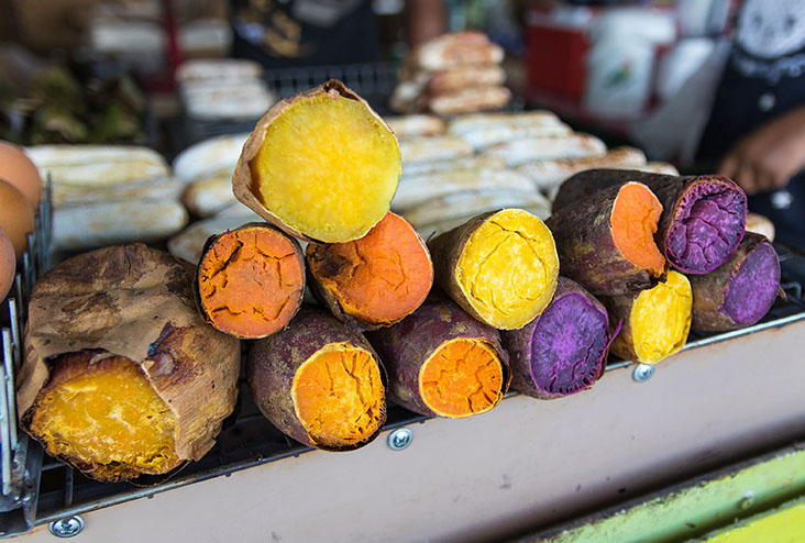Colorful sweet potatoes in market