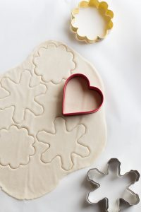 Cookie cutters on rolled out salt dough.