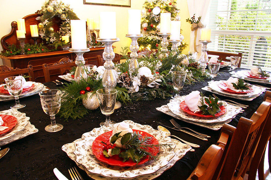 Traditional dining room table set for Christmas dinner.