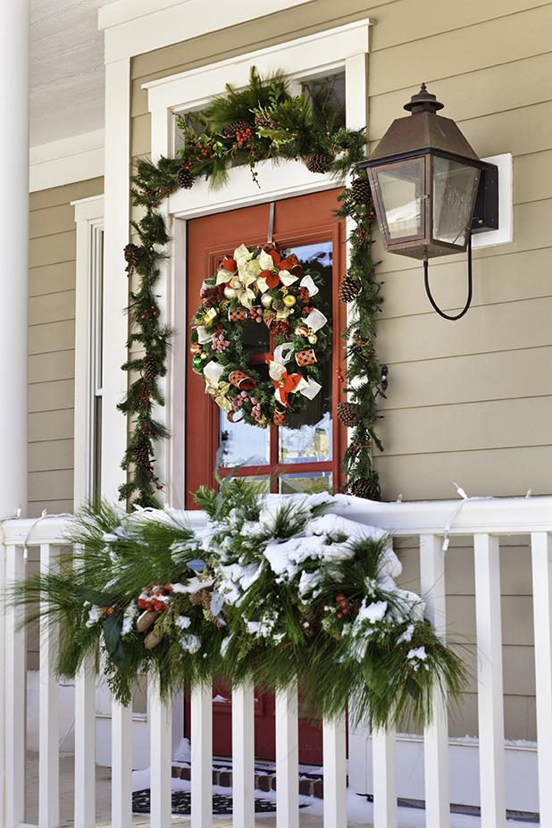 snow on porch with Christmas decorations